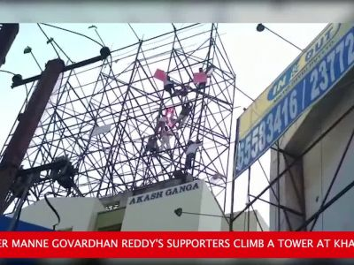On cam: TRS leader injures self with brick; supporters climb a tower in protest