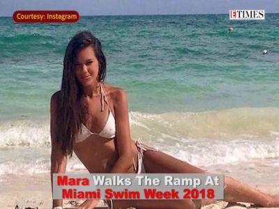 Swimsuit model Mara Martin breastfeeds her baby on runway