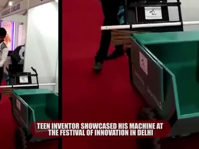 Teen inventor Shikanto Mandal displays use of his unique garbage collection machine