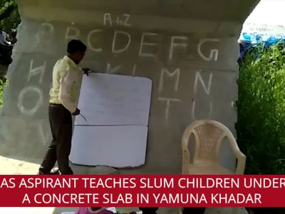 This guru teaches slum children under concrete slab near Yamuna Bank
