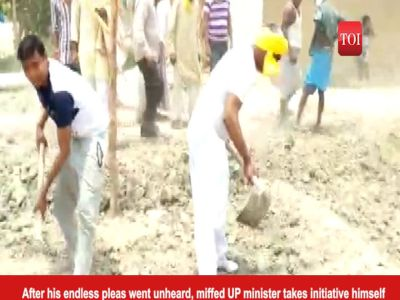 UP minister OP Rajbhar picks spade, repairs road himself with locals