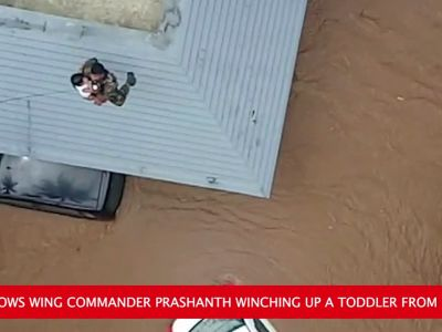 Watch: IAF officer rescues toddler from rooftop in Kerala