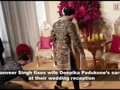 Watch: Ranveer Singh fixes wife Deepika Padukone's saree at their wedding reception, blows kisses